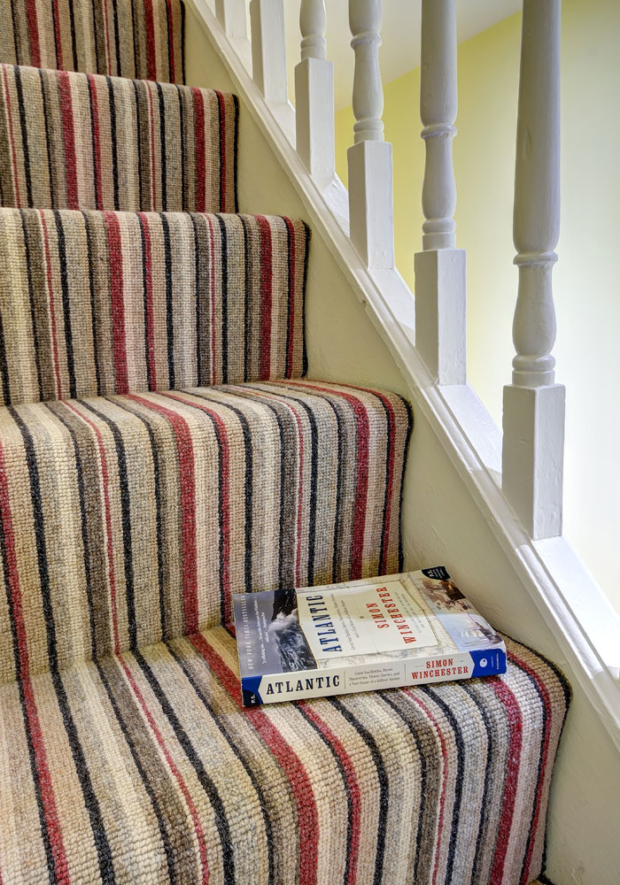 pattern carpet on stairs and book